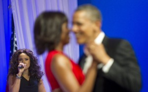 President Barack H. Obama, right, and first lady Michelle dance their first dance during a performance by Jennifer Hudson, left, at the Commander in Chief's Ball at the Washington Convention Center in Washington, D.C., Jan. 21, 2013. Obama was elected to a second four-year term in office Nov. 6, 2012. More than 5,000 U.S. Service members participated in or supported the inauguration. (U.S. Army photo by Staff Sgt. Sun L. Vega/Released)