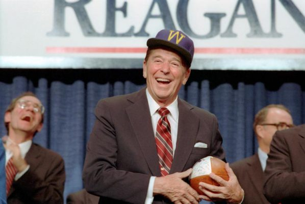 10/23/1984 President Reagan at a Reagan Bush 1984 Campaign rally receiving gift of hat and football from University of Portland Earl A. Chiles Center University of Portland